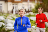 Senior couple jogging — Stock Photo