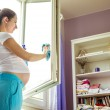 Woman cleaning the window — Stock Photo #49257113