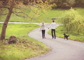 Couple taking a walk in park — Stock Photo