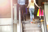 Couple go up the escalator — Stock Photo