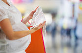 Woman looking at new baby clothes — Stock Photo