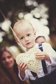 Boy with heart shape decoration — Foto de Stock