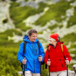 Tourist couple hiking at mountains — Stock Photo #49713355
