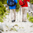 Legs of couple hiking at mountains — Stock Photo #49713439