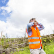 Rescue worker at destroyed forest — Stock Photo #49713505