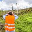 Rescue worker at destroyed forest — Stock Photo #49713527