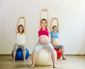 Pregnant women doing exercise — Stock Photo