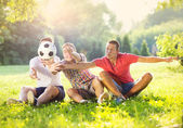 Friends playing with soccer ball — Stock Photo