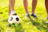Feet and football ball — Stock Photo