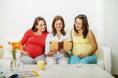 Pregnant women reading book — Stock Photo