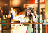 Girl standing in shopping mall — Stock Photo