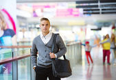 Man in shopping mall — Stock Photo