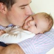 Newborn baby with his father — Stock Photo #50795787
