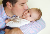 Newborn baby with his father — Stock Photo