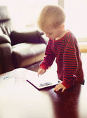 Boy is playing on tablet — Foto Stock