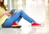 Teenage girl using digital tablet — Stock Photo
