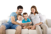 Family sitting on sofa — Stock Photo