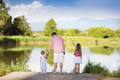 Father fishing with daughters — Stock Photo