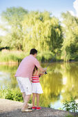 Father fishing with daughter — Stock Photo
