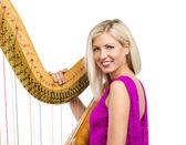 Elegant woman with harp — Stock Photo