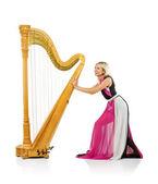 Woman with harp — Stock Photo