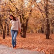 KrWoman in autumn park — Stock Photo