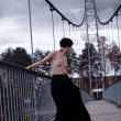 Naked woman on the bridge — Stock Photo #15350797