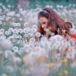 Royalty-Free Stock Photo: Girl in field of dandelions