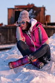 Young woman relaxing on snow — Stock Photo