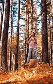 Girl hiding in autumn forest — Stock Photo