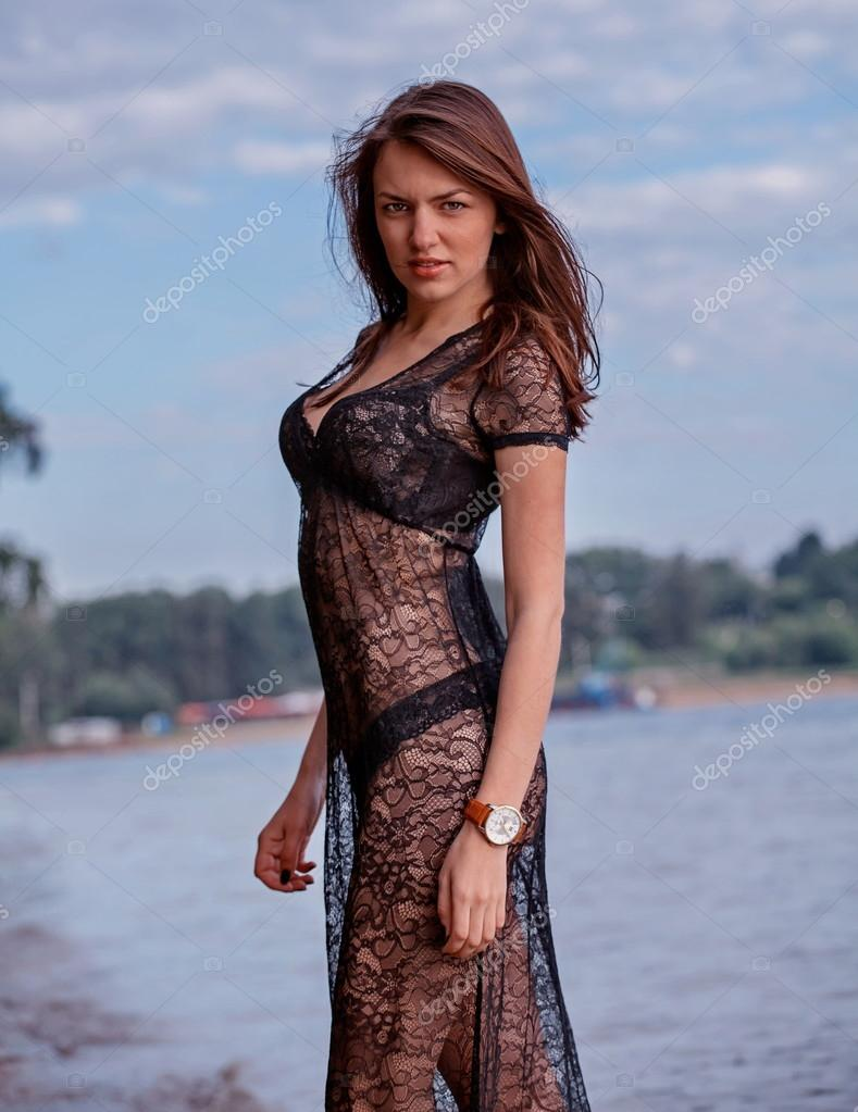 Fashionable woman in lacy dress with underwear by lake. — Stock Photo #15350419