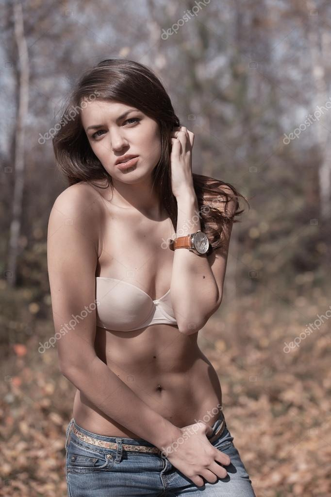 Beautiful woman in bra stood in autumn countryside with tree in background. — Stock Photo #15350489