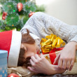 The little girl fell asleep with gift — Stock Photo
