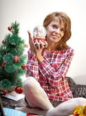 Smiling girl with snowglobe in her hand — Stock Photo