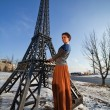 Stock Photo: Beautiful woman near the tower in winter