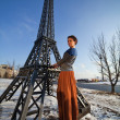 Beautiful woman near the tower in winter — Stock Photo