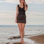 Fashionable woman by lake — Stock Photo