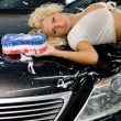 Beautiful woman washing a car — Stock Photo
