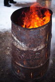 Iron barrel with fire — Stock Photo