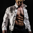 Muscular man with open shirt — Stock Photo