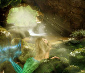 Young blonde mermaid — Stock Photo