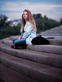 Blond woman sat on steps — Stock Photo