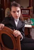 Girl sat in antique shop — Stock Photo