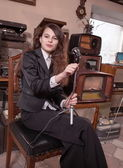 Girl in antique shop — Stock Photo