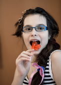 Girl eating candy — Stock Photo