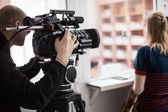 Videoperator shooting a reportage — Stock Photo
