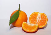 Orange mandarins with green leaf isolated on white background — Stock Photo