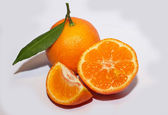 Orange mandarins with green leaf isolated on white background — Stock Photo