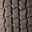 Very old used black tyre macro photo - Stock Photo