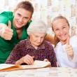Elderly woman with the young doctors — Stock Photo #15345457